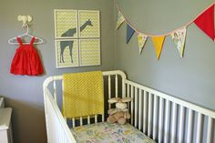 Grey and yellow nursery with girly details.