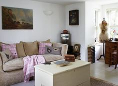 Anchor your living room scheme with a large central storage chest that can double as a coffee table. Fill with living room paraphernalia, such as magazines and spare blankets or throws, and free up surface space for coffee mugs and remote controls.