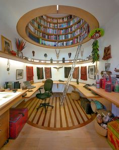Wonderful Interior Design Ideas  Modern, circular and fun library! A ladder leads to the cubby at the top, while leaving space for the office desk at the bottom.  A clever use of space, and bright touches of color to boot.