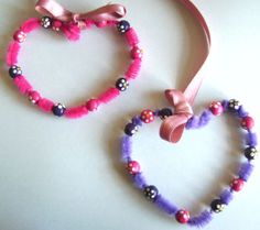 Heart craft made from chenille stem and beads. Valentine crafts for kids