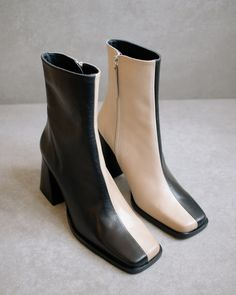 td {border: 1px solid #ccc;}br {mso-data-placement:same-cell;} Two tone color boots Get the quintessential 90s look with the wide block heel on this slim ankle boot. Zips along the side to elongate the legs and create a flattering silhouette. Available as a wardrobe basic in black or bicolor for a daring add to any fall winter look. DETAILS Product Type: Ankle Boot Heel Height: 8 cm Material: Leather Color: Black November Drop (FW 20/21) Made in Spain ON DEMAND Why choose pre-order? Early bird d Black Leather Boots, Cow Leather, Heeled Boots, Ankle Boots, Boot Types, Beige, Winter Looks, Fall Winter, Autumn