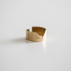 Hand-formed in thin brass with a unique cut out, this unique ring makes a unique statement.   Brass.  Handmade with love in Honduras.