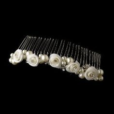 """Kimberly Pretty Pearl Bridal Hair Comb by Fairytale Bridal Tiara. $44.00. Rhinestones. Faux Pearls. Silver Plated. Pretty rose floral bridal hair comb accented with sparkling rhinestones and faux pearls.  Size: 4 3/4"""" long by 3/4"""" wide"""