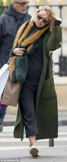 Covering up: Amid rumours she is pregnant, Lara has been wearing bulking layers of clothin...