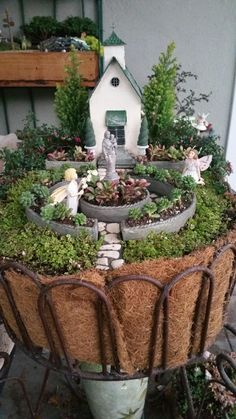 Miniature Fairy Garden - IN AWE. Two girl fairies who are IN AWE of the Blessed Mother and Baby statue at the Christian Village Church.
