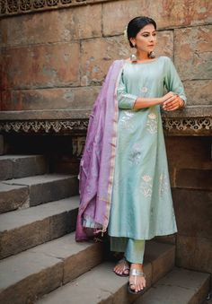A cool minty green set made out of pure Chanderi paired with a dash of lavender. Zari detailing on the dupatta and silver sequence on the Kurta adding a splash of grace to your festive proceedings. Ethnic Outfits, Ethnic Dress, Indian Outfits, Quirky Fashion, Ethnic Fashion, Indian Fashion, Frock Fashion, Fashion Outfits, Simple Indian Suits