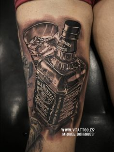 Black and grey Jack Daniel's whiskey bottle tattoo on the right thigh.