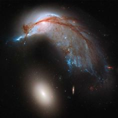 Penguins in spaaaaaaaaaace! This image shows the two galaxies interacting. NGC 2936, once a standard spiral galaxy, and NGC 2937, a smaller elliptical, bear a striking resemblance to a penguin guarding its egg. Image released June 20, 2013.