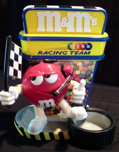 M&M's collectible toy candy dispenser waving checkered flag