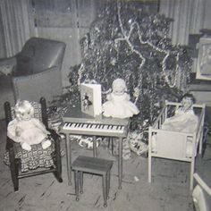 Baby dolls' Christmas morning. Oh my, I love this picture. I had a little piano like that. :)