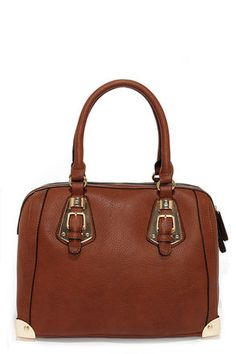 A real game changer, our Split to Spare Brown Handbag really knows how to get the crowd going! This chic bowling style handbag is constructed from a rich brown, pebbled vegan leather with black piping, plus an exterior zip pocket, and charming shiny gold buckle accents. A sturdy flat bottom design is protected by matching gold feet and corner hardware. Unzip the top closure to find a roomy fabric-lined interior in an ornate print complete with three side pockets. Carry by twin handles with a…