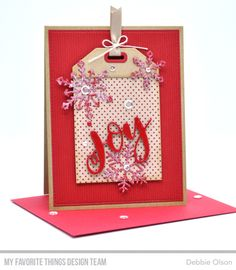 used the Joy Die-namics, paired with the Let It Snowflake Too Die-namics (which is a free with $60 purchase die set this release). I also used the new Cross-Stitch tag Die-namics (without the cross-stitch panel) and some older patterned paper, the ItsyBitsy Polka Dots Kraft Collection. For the background, I used the Scattered Surface Background stamp in Chili Powder ink on a Cherry Crisp cardstock.