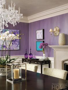 Purple washed walls and fun artwork in this Dining Room   Interior Designer Gerald Pomeroy Styled By: Kyle Hoepner Photographer: Bruce Buck