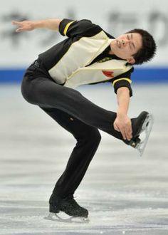 Japan's Takahiko Kozuka performs during the men's short program