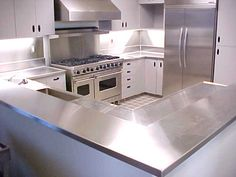 Image from http://www.cnbhomes.com/wp-content/uploads/2014/12/budget-stainless-steel-countertop-B1DRc.jpg.