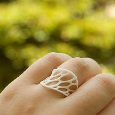A delicate organic ring inspired by the complex cellular forms of nature and generated by a computer simulation of spring meshes. The ring is built up layer by