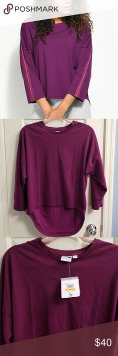 """NWT PUMA TAPE LS TOP (DARK PURPLE COLOR) A refined athletic look for your wardrobe. Whether you're getting your yoga on, hitting the pavement or heading to class. This activewear 3/4-tee and batwing sleeves and a sheer material on the back. The Tape Tee has DryCELL moisture management and a hi-low hemline for a flattering silhouette.Flowy loose fit.  23"""" (front) from top shoulder seam to bottom hem.29"""" (back) from top shoulder seam to bottom hem. These are measurements for size Small Puma…"""