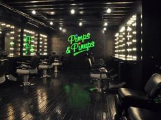The dark and cool design of the New York outpost of the east London hair salon Pimps & Pinups. Looks at the nice bright green logo design, which they carry over to their own brand products as well.  #pimps&pinups #newyork #shoreditch #london #salonideas #saloninteriors http://belliatasalonsoftware.com