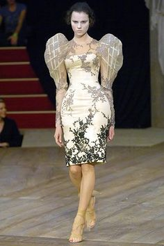 This outfit appeared in Alexander McQueen's spring 2007 runway show. The sleeves on this dress closely resemble the gigot sleeve, a popular style in the 1890s.