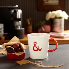 """Starbucks® Valentine's Mug, 12 fl oz    The perfect Valentine's Day gift for everyone you love. This cream-colored coffee mug is accented with a bright red handle and a big red ampersand – a symbol that couples together the """"YOU"""" and """"ME"""" on the mug's interior. Dishwasher and microwave safe, the 12-fl oz ceramic mug comes gift-ready in an acetate box with a red ribbon handle.  $7.95"""