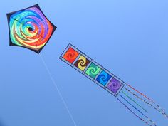 From the Shavit Kite Gallery. This pentagon kite design has a tail that has an effect like a train of small art kites. T.P. (my-best-kite.com)