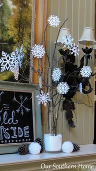 Creating A Cozy Winter Mantel - Our Southern Home Use Auntie Evie's crocheted snowflakes for a winterscape