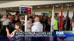 Honor Flight of WWII vets greeted at DC airport
