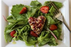 """Talk about """"hearting"""" walnuts! Here, heart shaped wedges of soft Chevre cheese are crusted in crunchy, lightly toasted California grown red walnuts, and placed on a bed of lightly dressed greens, with sweet sliced strawberries."""