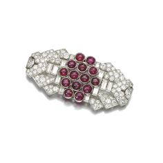 Ruby and diamond brooch, Ostertag, 1930s Of geometric design, collet-set with cabochon rubies, baguette and circular-cut diamonds, signed Ostertag, French assay and partial maker's mark.