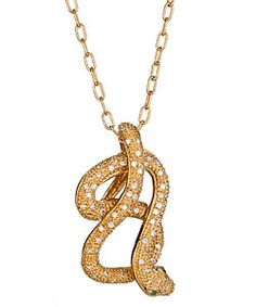 A coiled snake with allover white cubic zirconia details and two piercing emerald green cubic zirconia eyes.