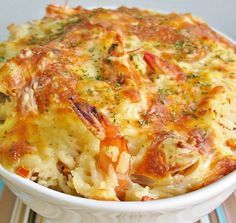 This is a wonderful casserole that contains, lobster, shrimp and crab meat. Mix all ingredients add to a oven proof casserole dish, and bake in a preheated 350 degree oven for 20-30 minutes. Serve with rice. Recipe may be doubled if desired.