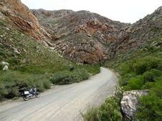 ... - Photo of The caves are a focal point on Seweweekspoort Pass