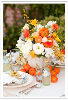 Gray And Orange Wedding Centerpieces | Oranges as centerpiece via One Charming Party