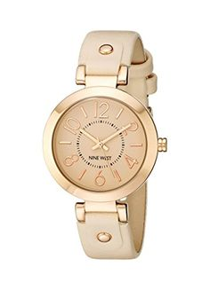 Round watch featuring matte blush pink dial with raised stick and Arabic markers 32 mm rose gold-tone stainless steel case with mineral dial window Japanese quartz movement with analog display