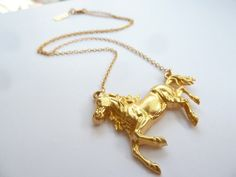This is a picture of a horse necklace. Penelope likes to go to the Saturday market in her town and visit 3 different booths each time she's there. Lo likes to collect beautiful things, and in fact her room is entirely filled with what most would call garbage, but to her, her trinkets are everything. They are what keeps her sain. Anyways, while she's at the market she comes across this one booth, and she instantly see's the horse pendant. She knows that's one of the things that was missing…