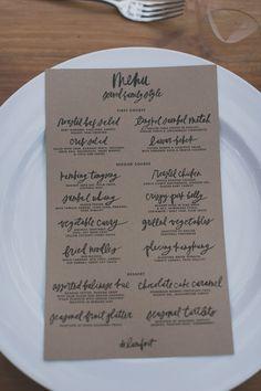 kraft paper menu - photo by Jonas Peterson http://ruffledblog.com/exotic-garden-party-wedding-in-bali #weddingmenu #papergoods #calligraphy
