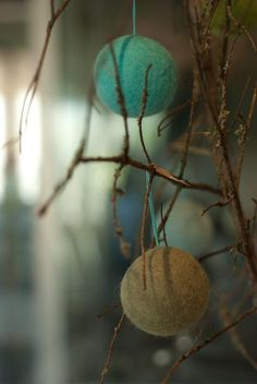 Wool felt spheres on branches. These would look great in red & green.....
