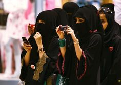 May mothers here raise their children to honor the Lord who sets captives free. - Arabian women in face-covering niqab snap photos of their children during an Independence Day celebration in Riyadh, Saudi Arabia. Muslim Girls, Muslim Women, Muslim Veil, Saudi Men, Tribes Of The World, Women Right To Vote, Arabian Women, Saudi Arabia, Arabia Saudí