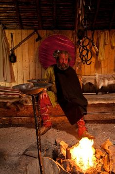 All the reconstructed Viking houses I've been into are snug and warm (the one at L'Anse aux Meadows is equipped with a gas-fired hearth), the benches thick with furs and skins, the Vikings well covered in bright, finely woven cloth, metal pots and pans all over the place. L'anse Aux Meadows, Viking House, Furs, Hearth, Benches, Vikings, Snug, Houses, Bright