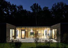 Kraus Schoenberg Architekten nursery opens up to forested site in Hamburg