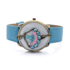 Share the delicate portrait of this STRADA Collection Japanese movement watch. The inner child in you will embrace the graceful feminine figure with blue Austrian crystals featured in the cover. It opens up to tell time outlined in goldtone with a blue leather strap. A young daughter or niece will also enjoy its company. Free Shipping Gift Box
