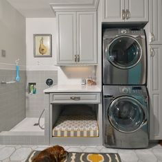 Amazing! Not only is it a laundry room, but it's also a shower and bedding spot for your four legged baby!
