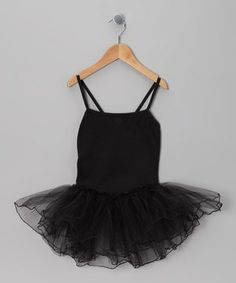 This cozy cotton wonder is perfect for spirited dance rehearsals or seriously fun dress-up sessions. It boasts a frilly skirt for extra twirling power!