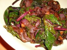 Beet Greens with Caramelized Onions.  Something like this with my beet greens this week perhaps..