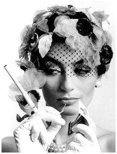 Anouk Aimée & cigarette holder (Photographer: William Klein - 1961)