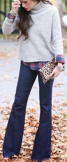 Flare Jeans + Grey Sweater + Plaid Shirt                                                                             Source