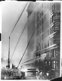 Firefighters work to put out the Triangle Shirtwaist Factory fire, March 25th, 1911