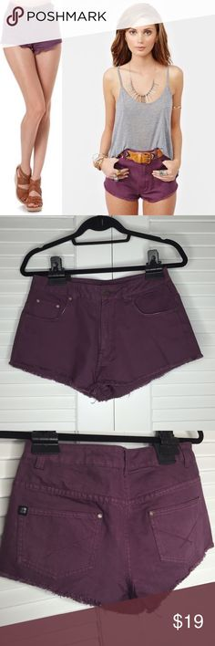 """Nasty Gal Insight Spokes Short Plum Worn only a few times. Totally rad plum denim cutoffs featuring a high waist and silver hardware. 5-pocket style with a button/zip closure. Perfect paired with a crop top and lace-up boots! By Insight. 100% Cotton 9.25'' length; 1.25"""" inseam.   Size 6= 28"""" waist Nasty Gal Shorts Jean Shorts"""