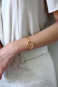 A hand fabricated cuff, organically shaped. Available in gold plated or sterling…