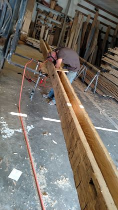 Hand hewn beam in the process of being hollowed out
